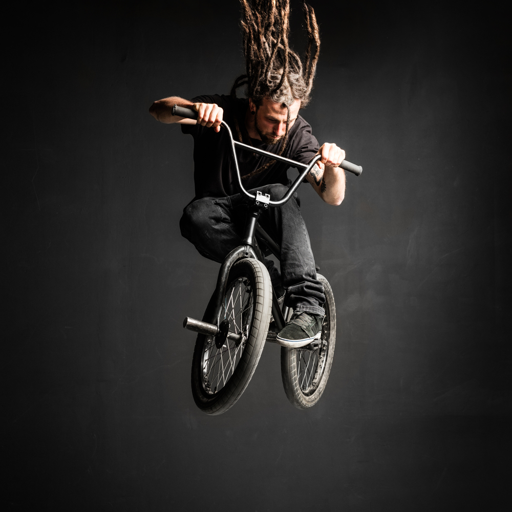 Canva_-_young_man_with_dreadlocks_jumping_on_his_bmx_bike._(2)-7e941a0261890087fe32443d718b20b